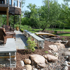 Traditional Deck by Urban Escapes