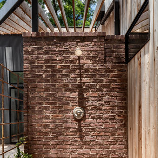 Design ideas for a contemporary deck in Austin with an outdoor shower and a pergola.