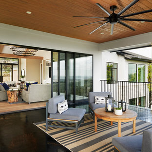 Deck - transitional deck idea in Austin with a roof extension