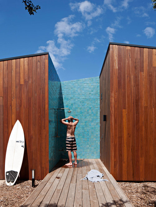 Beach Style Backyard Deck In Geelong With An Outdoor Shower And No Cover.