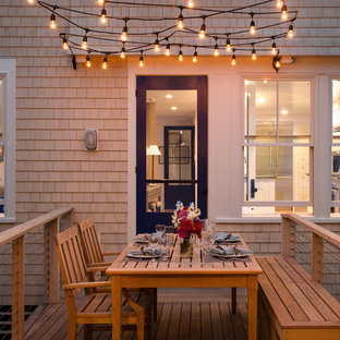 Example of a beach style deck design in Portland Maine with no cover
