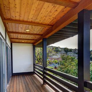 Diseño de terraza de estilo zen, de tamaño medio, en anexo de casas