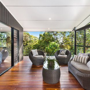 This is an example of a contemporary deck in Wollongong with a roof extension.