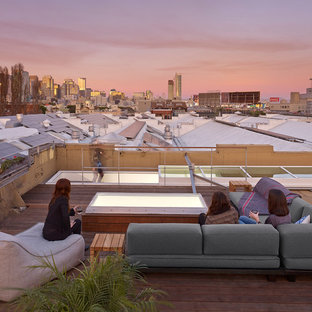 Deck - large industrial rooftop rooftop deck idea in San Francisco with no cover