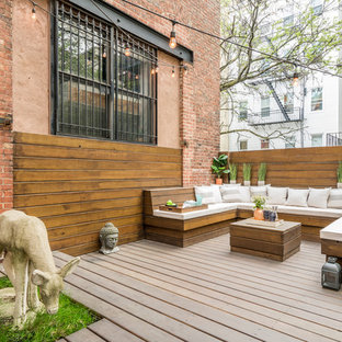 Inspiration for a mid-sized eclectic backyard deck in New York with no cover.