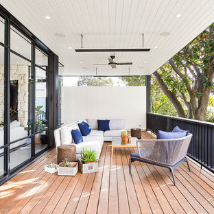 Photo of a contemporary deck in Melbourne with a roof extension.