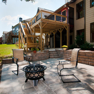 Example of a large classic backyard deck design in Atlanta with no cover