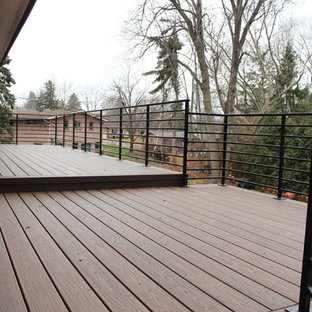 Example of a small trendy backyard deck design in Detroit with no cover