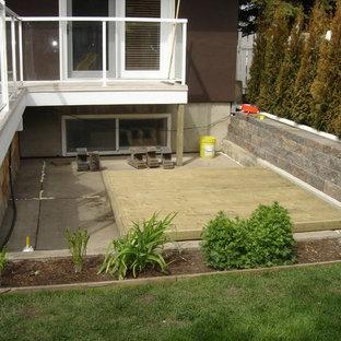 Foto di piccoli terrazze e balconi dietro casa con fontane