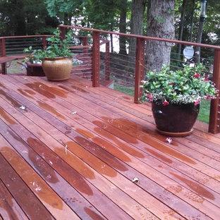 Outdoor kitchen deck - huge traditional backyard outdoor kitchen deck idea in Charlotte