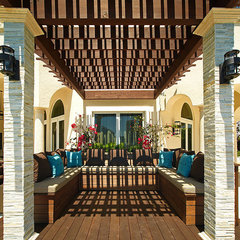 mediterranean patio by b+g design inc.