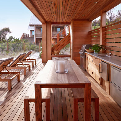 Inspiration for a large coastal backyard outdoor kitchen deck remodel in New York with a roof extension