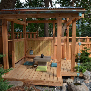Example of an asian backyard deck design in Minneapolis