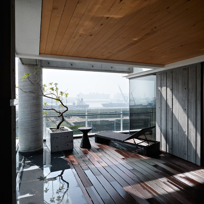 Example of a trendy deck container garden design in Other with a roof extension