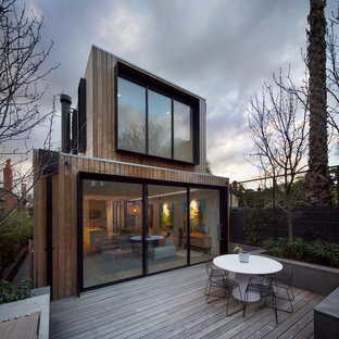 Contemporary backyard deck in Melbourne with no cover.