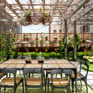 Design ideas for a large contemporary rooftop deck in New York with a container garden and a pergola.