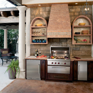 Outdoor kitchen deck - large traditional courtyard outdoor kitchen deck idea in Cleveland
