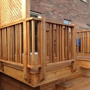 This is an example of a mid-sized traditional backyard deck in Toronto with no cover.