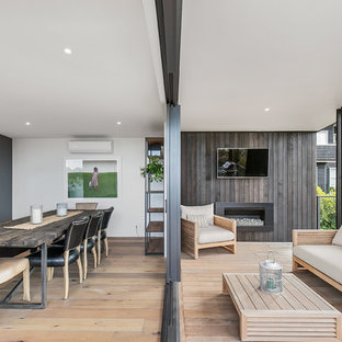 Deck - contemporary deck idea in Auckland with a fireplace and a roof extension