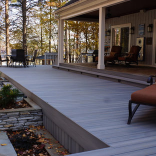 Deck skirting - huge traditional backyard deck skirting idea in Charlotte with a roof extension