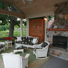 Traditional Deck by Boardwalk Design-Build Inc.