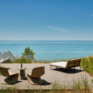 Design ideas for a beach style deck in Chicago with with dock and no cover.