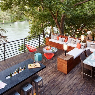 This is an example of a large traditional back terrace and balcony in Dallas with no cover.