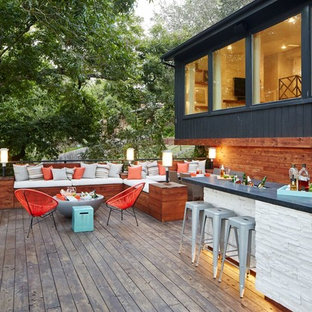 Inspiration for a large contemporary back terrace and balcony in Dallas with no cover and an outdoor kitchen.