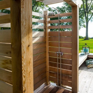 Inspiration for a mid-sized beach style backyard deck in Milwaukee with a pergola and an outdoor shower.