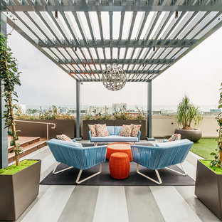 Trendy rooftop deck container garden photo in Los Angeles with a pergola