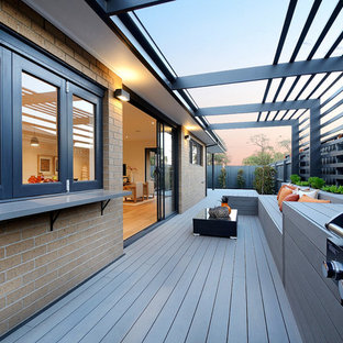 Photo of a large contemporary side terrace and balcony in Melbourne with no cover.