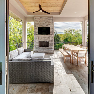 Deck - transitional backyard deck idea in Kansas City with a fireplace and a roof extension