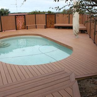 Inspiration for a large scandinavian backyard outdoor shower deck remodel in Melbourne