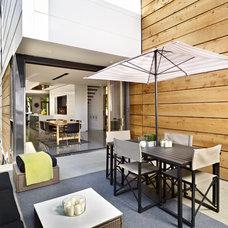 Modern Deck by Richlyn Custom Homes