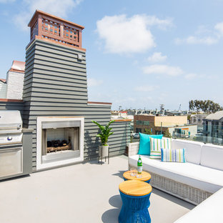 Mid-sized coastal rooftop deck photo in Orange County with a fireplace and no cover