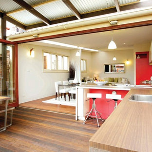 Outdoor kitchen deck - contemporary outdoor kitchen deck idea in Sydney with a roof extension