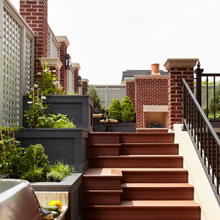 Photo of an expansive traditional rooftop deck in Chicago with a fire feature.