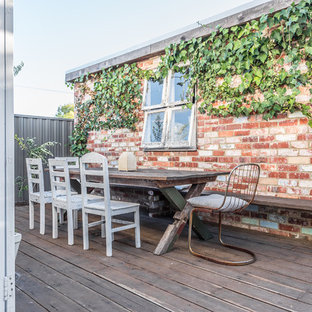 Example of a cottage chic rooftop deck design in Perth with no cover