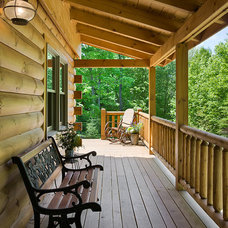 Rustic Deck by Coventry Log Homes