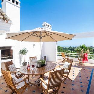 Foto de terraza mediterránea, de tamaño medio, sin cubierta, en azotea