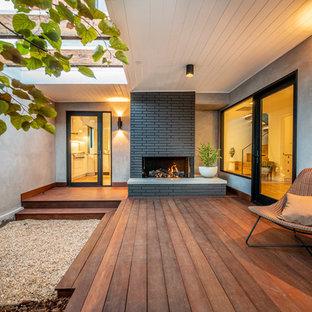 Foto de terraza contemporánea, de tamaño medio, en anexo de casas
