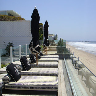 Deck - beach style backyard deck idea in Los Angeles with no cover