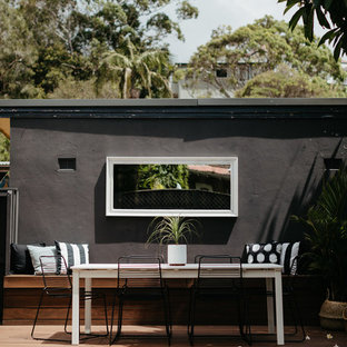 Design ideas for a small beach style backyard deck in Sydney with no cover.