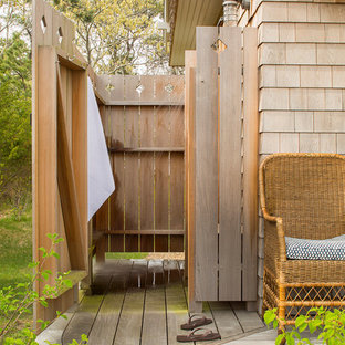 Inspiration for a beach style side yard outdoor shower deck remodel in Boston