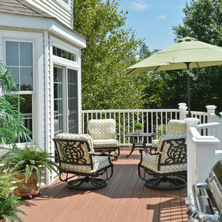 Inspiration for a large timeless backyard deck remodel in New York