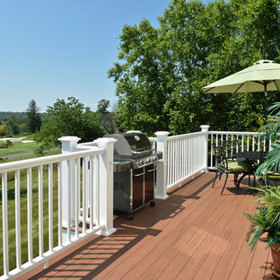 Deck - large traditional backyard deck idea in New York