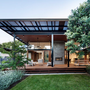 This is an example of a contemporary backyard deck in Adelaide with an outdoor kitchen and a roof extension.