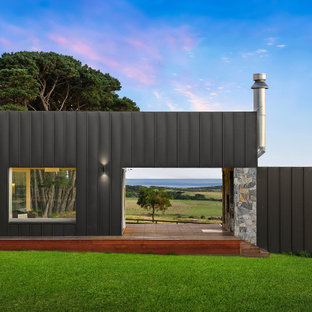 Inspiration for a mid-sized country backyard deck remodel in Melbourne with a fireplace and a roof extension