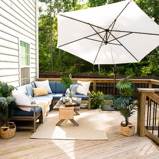 Inspiration for a mid-sized transitional backyard deck remodel in Richmond with a fire pit