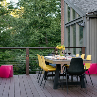 Large midcentury backyard deck in Boston with a fire feature and no cover.